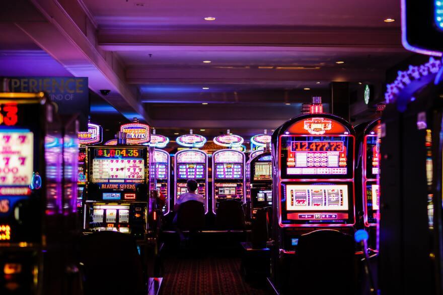 A photo of slot machines in a casino.