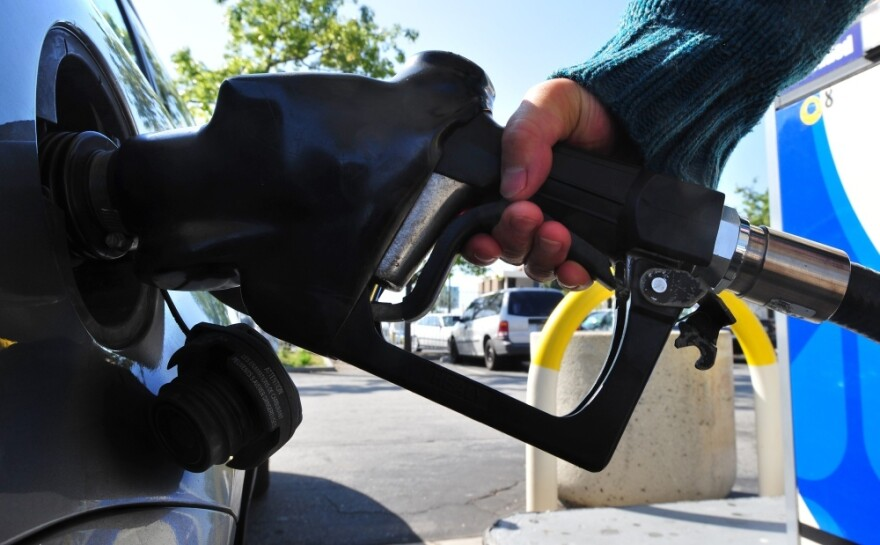 A driver pumps gas in Los Angeles, where prices are among the highest in the country, topping $4 a gallon.
