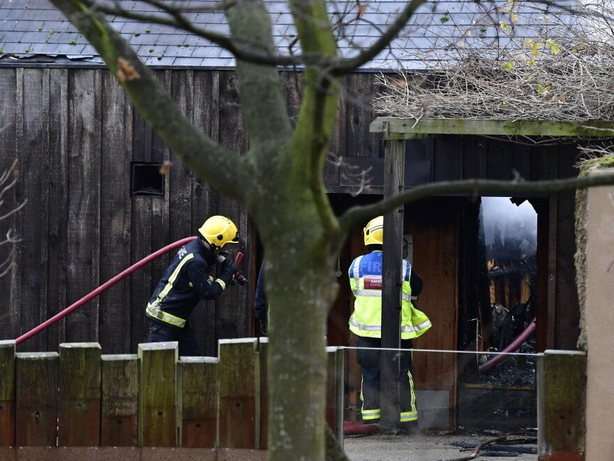 Firefighters at the London Zoo on Saturday, where an early morning fire killed at least one animal.
