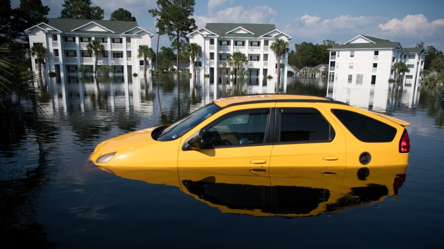A car is inundated with floodwaters from Hurricane Florence at an apartment complex at Aberdeen Country Club on Thursday in Longs, S.C.