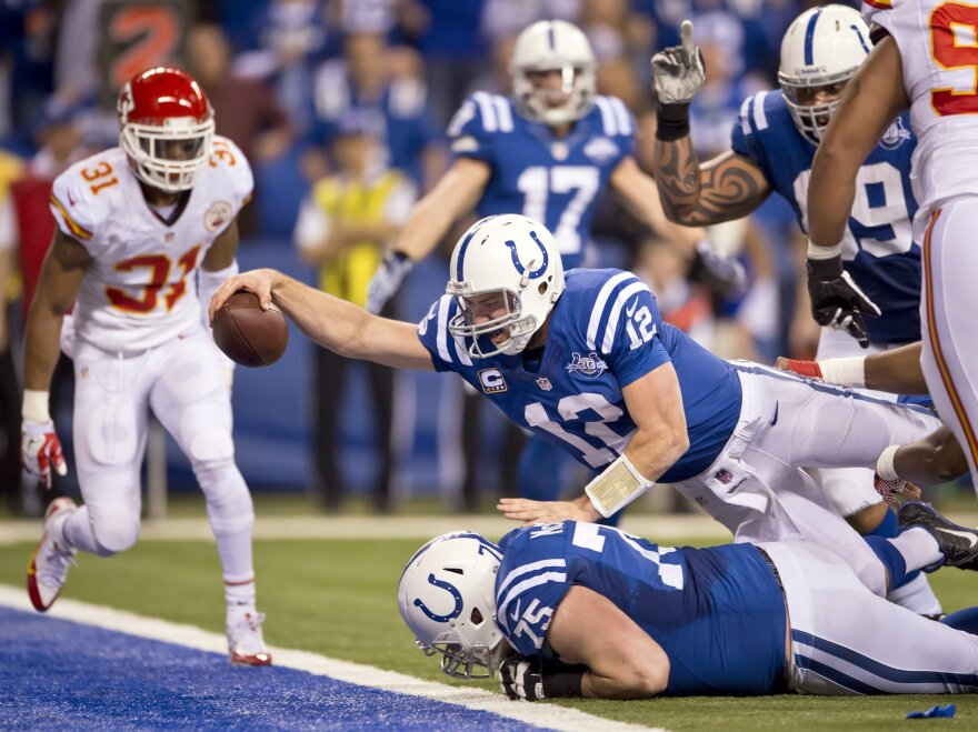 Indianapolis Colts quarterback Andrew Luck dives over the goal line in the fourth quarter of his team's 45-44 victory over the Kansas City Chiefs.