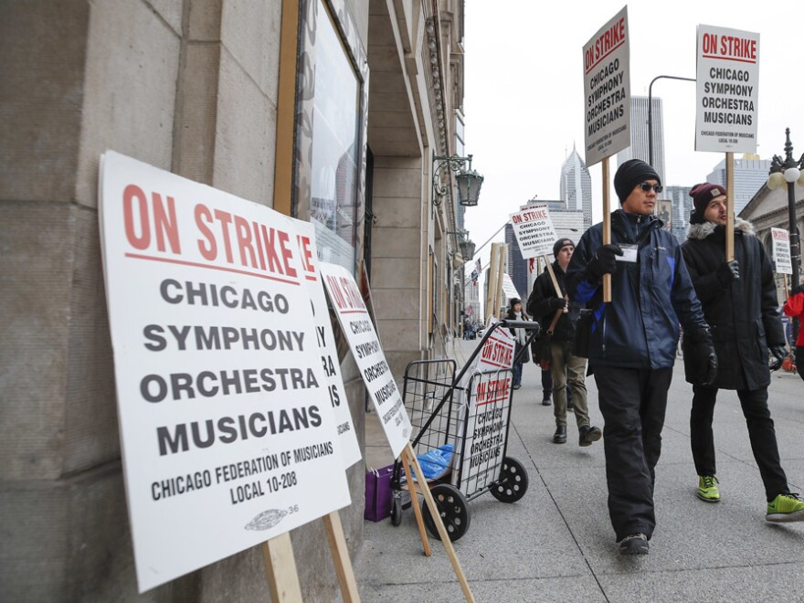 Members of the Chicago Symphony Orchestra carry signs as they strike on March 11, 2019 in Chicago, after 11 months of talks failed to reach an agreement.