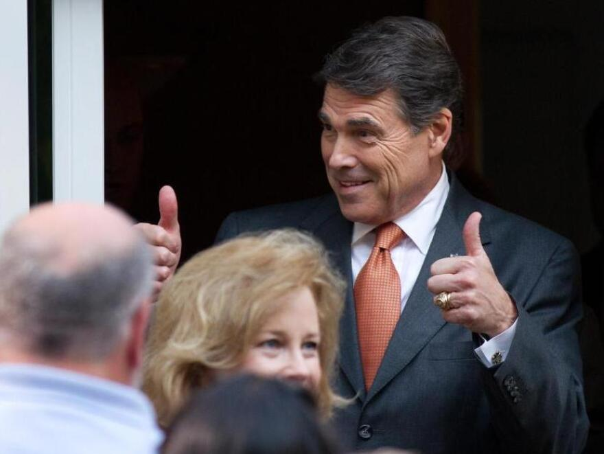 Texas Gov. and Republican presidential hopeful Rick Perry gives a thumbs up as he arrives at a campaign event at the home of New Hampshire State Rep. Pam Tucker on August 13, 2011 in Greenland, New Hampshire.