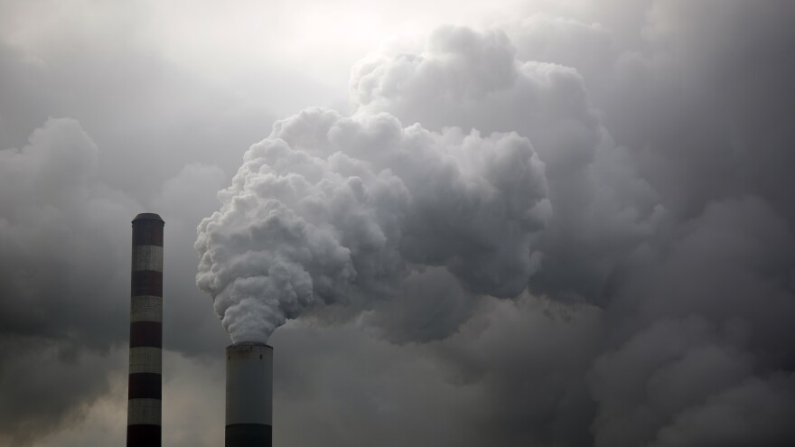 Water vapor rises from a coal powered power plant stack. Pollution from burning coal affects a larger area than vehicle emissions.