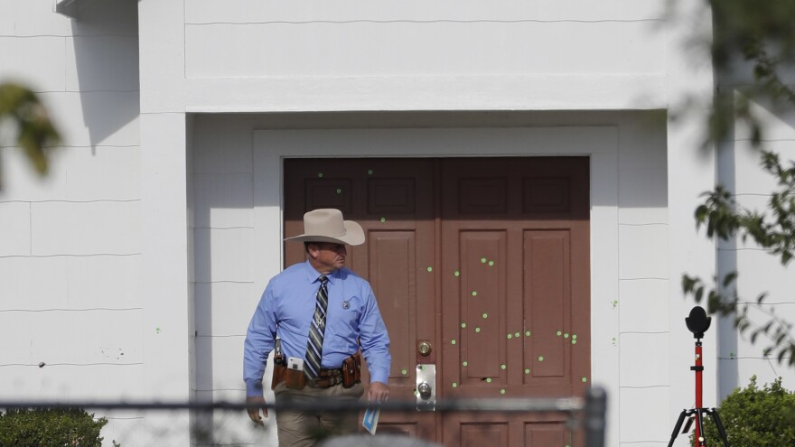 A law enforcement official leaves the First Baptist Church on Tuesday, in Sutherland Springs Texas.