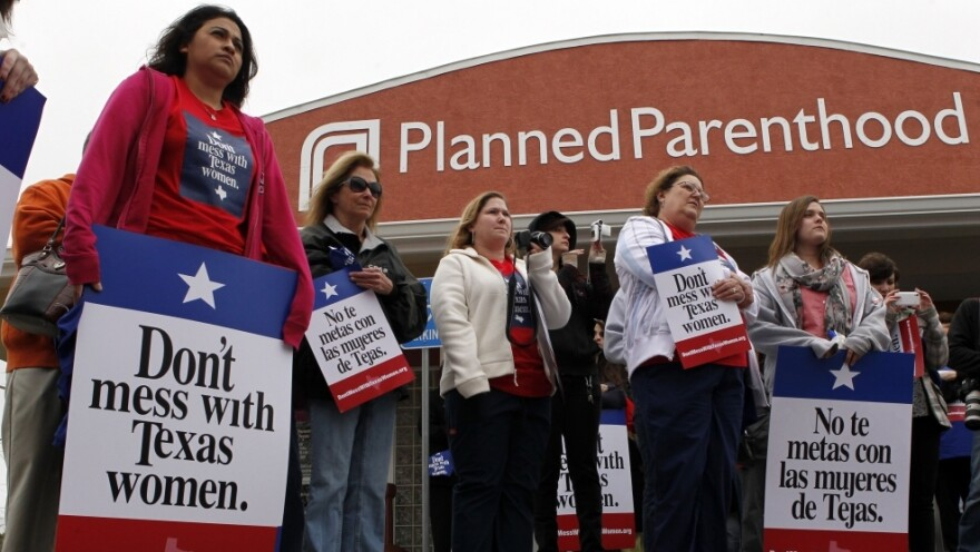 """Local citizens and employees of the Planned Parenthood clinic in San Angelo, Texas gather in front of the clinic Thursday, March, 8, 2012 to participate in the """"Don't Mess with Texas Women"""" rally."""