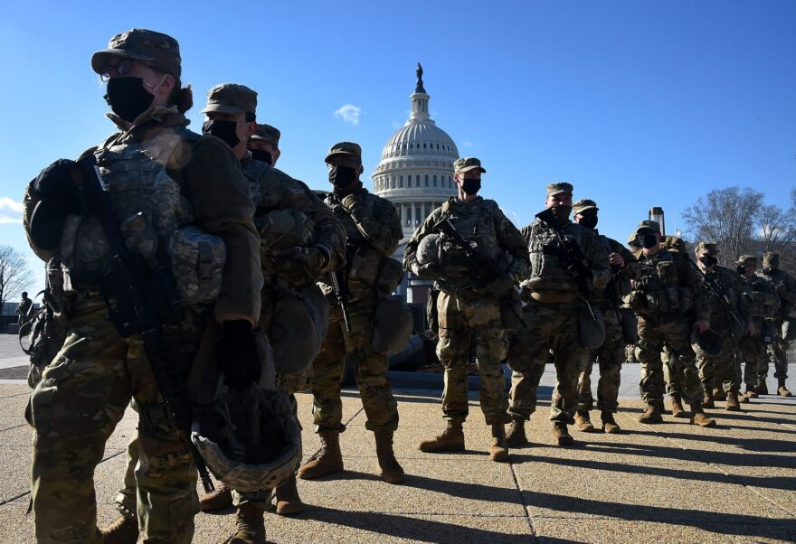 Members of the National Guard gather at a security checkpoint near the US Capitol, ahead of the 59th inaugural ceremony for President-elect Joe Biden and Vice President-elect Kamala Harris in Washington, DC.