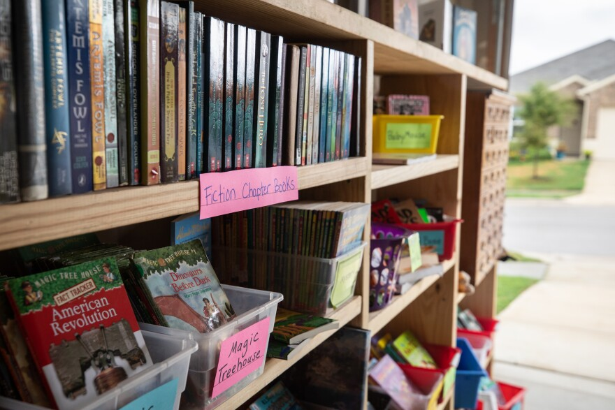 Nearly 2,000 books line the shelves of a makeshift library in East Travis County.