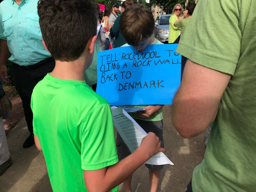 A boy protests the Rockwool company with his family on Aug. 2, 2018 in Charles Town, W.Va.