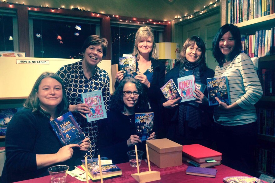 Linda Johns (lower row, center), in the first moments of her heart attack. She's with fellow authors Kristen Kittscher, Kirby Larson, Suzanne Selfors, Sara Nickerson and Jennifer Longo at Queen Anne Book Co. in Seattle.