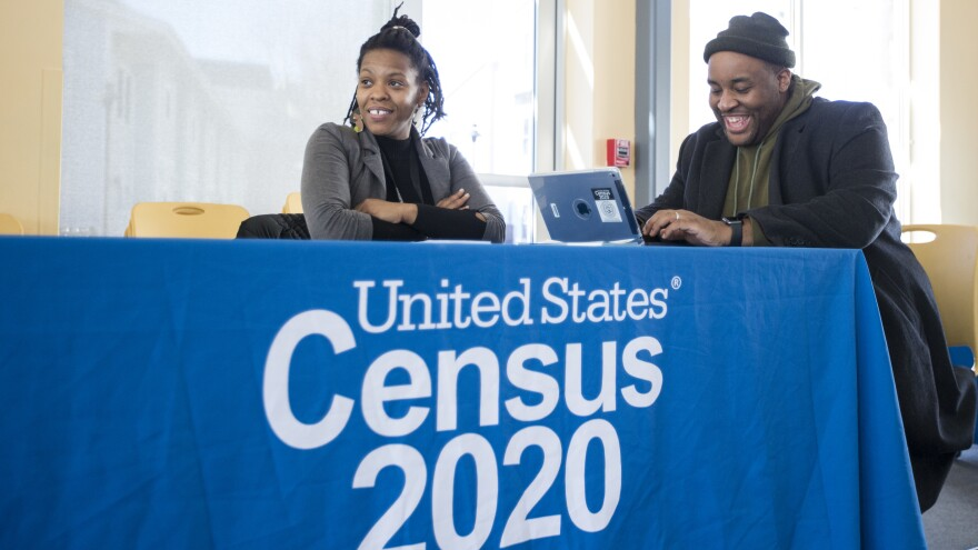 Chris Worrell (right) jokes with Teresa Jefferson while applying for a 2020 census job in Boston in February before the COVID-19 pandemic.