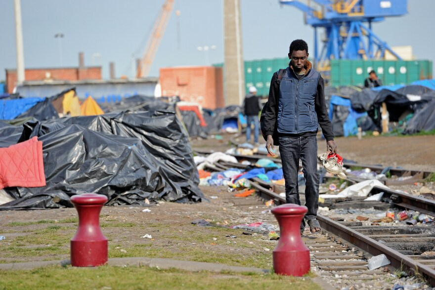 A man walks through a makeshift camp set up by migrants in Calais on May 17. There are an estimated 2,000 migrants in limbo in Calais.