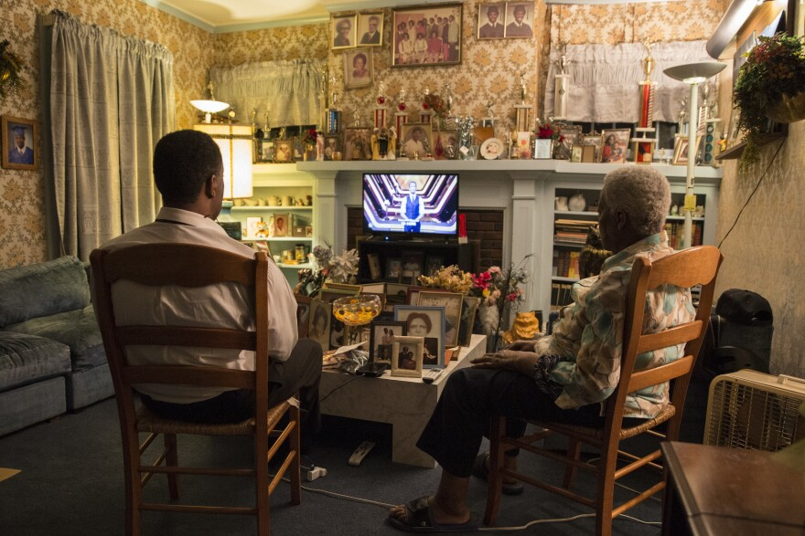 Charleston has stayed with his mother every Sunday and Wednesday since his father passed away in 2014. Here, they watch television together on a Sunday night.