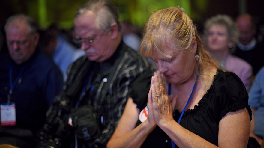 Attendees pray during The Family Research Council's Values Voter Summit on Sept. 14 in Washington, D.C.