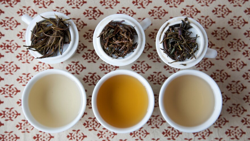 Three varieties of Kenyan purple tea from What-Cha: silver needle purple varietal white tea (from left), hand-rolled purple varietal oolong, steamed purple varietal green tea-style tea.