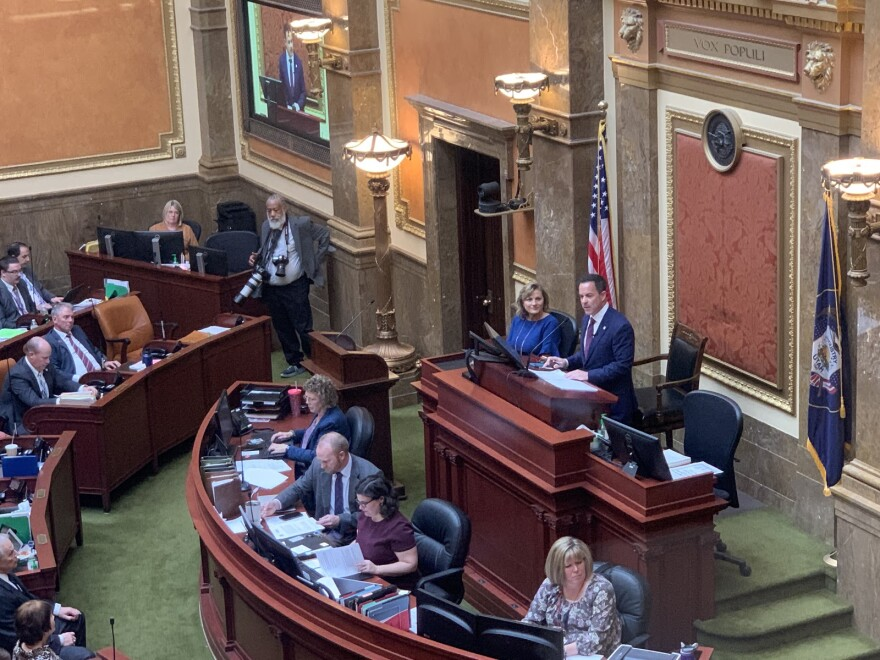 Photo looking down at the House floor where Brad Wilson addresses representatives.