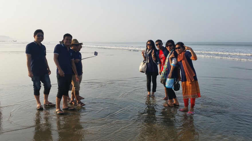 Tourists gather on the beach in Cox's Bazar, Bangladesh's current beach destination.