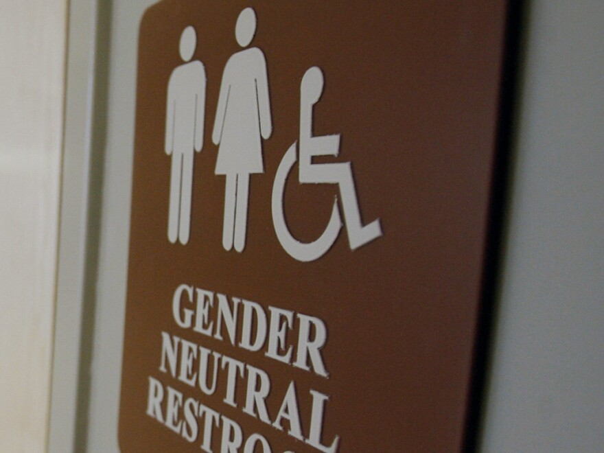 A sign marks the entrance to a gender-neutral restroom at the University of Vermont in Burlington, Vt. in 2007.
