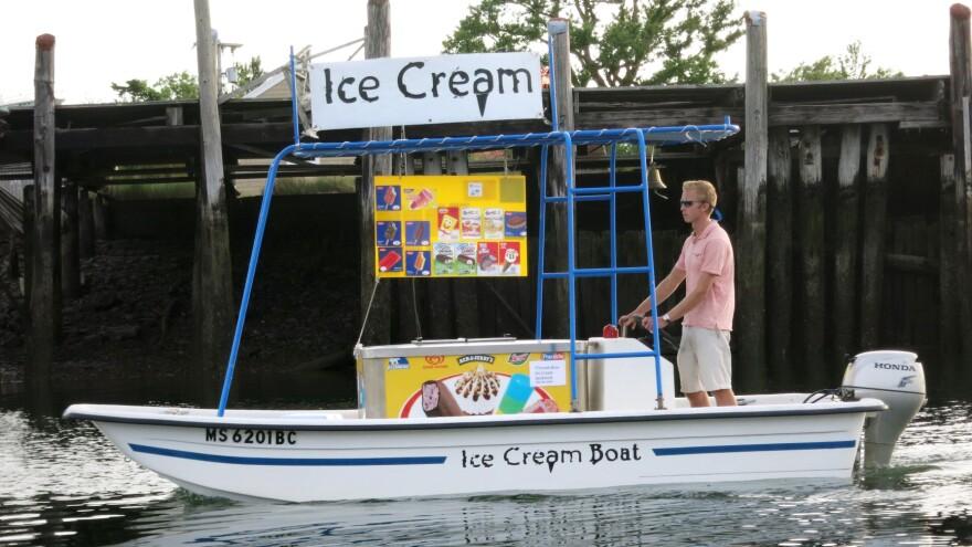 Captain Tim Titcomb maneuvers his 15-foot Carolina skiff along the sandy beaches of Sampson's Island, Mass., in July 2014.