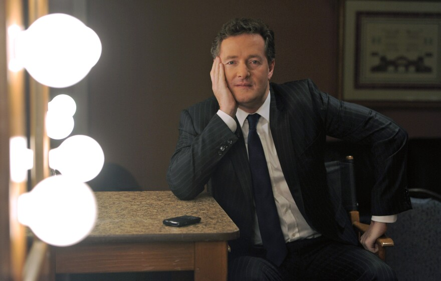 Piers Morgan poses for a portrait backstage during a 2011 press tour.