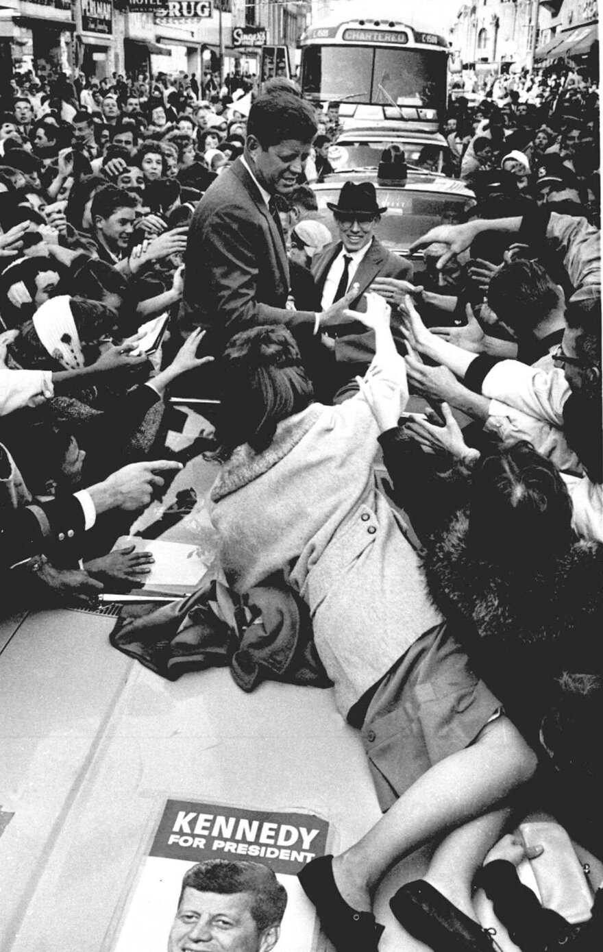Kennedy is surrounded by supporters in 1960 as he campaigns in Elgin, Ill.