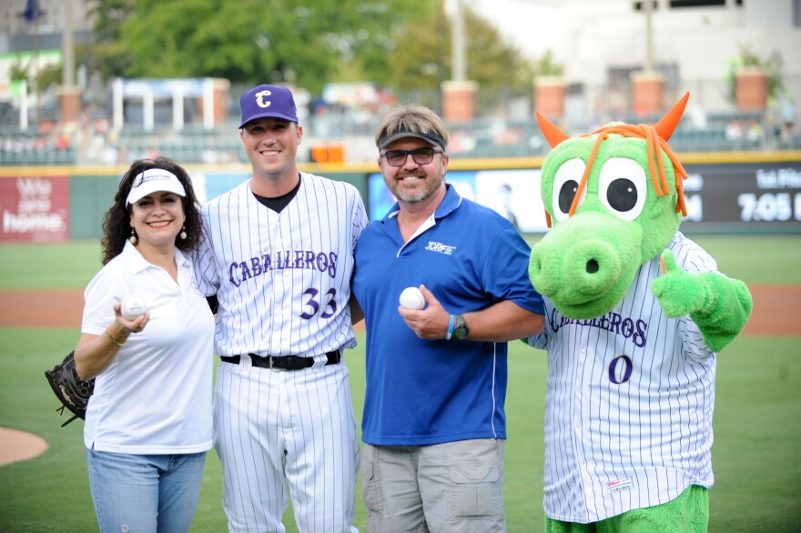 The Knights are the Caballeros this weekend. Posing after the first ball was thrown out were Rocio Gonzalez of the Latin American Chamber of Commerce; catcher Rob Brantley;  Jim Huffman, who was there with the local Juvenile Diabetes Research Foundation c