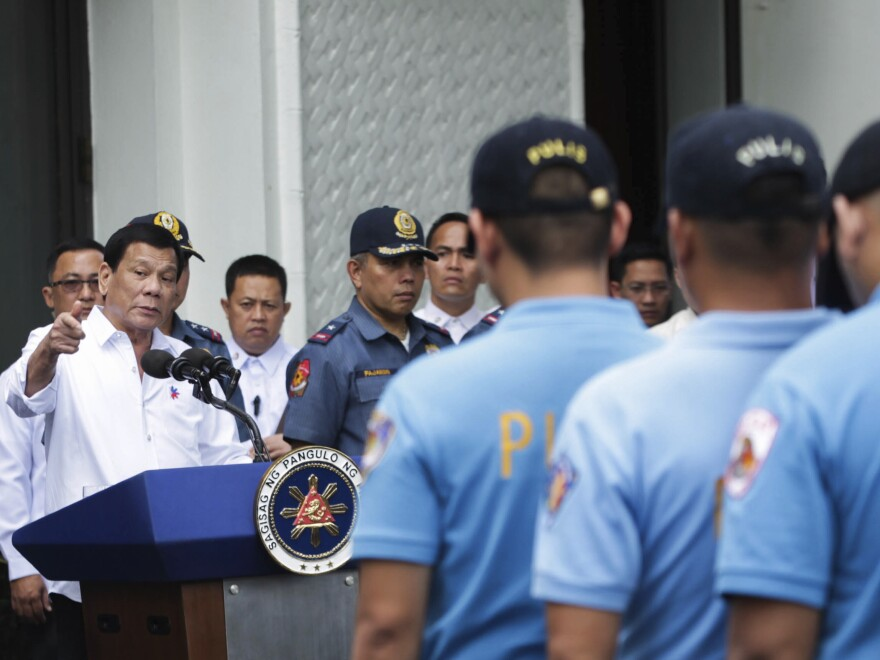 Philippine President Rodrigo Duterte berates police officers at the presidential palace in Manila on Feb. 7, after learning of the murder of a South Korean businessman. In expletive-laden remarks, Duterte told police he'd send them to a southern island to fight extremists from the Abu Sayyaf terrorist group.