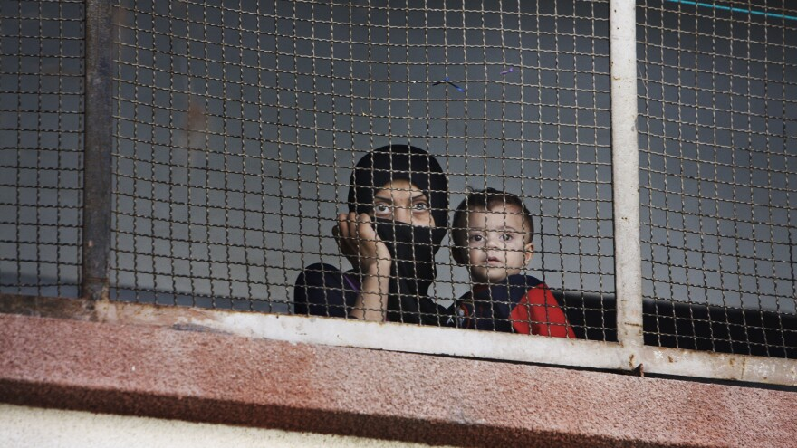 Many Syrians in the capital Damascus are feeling cooped up by the ongoing war. Here, a woman and her child who fled the fighting in their home area take refuge at a school in Damascus last September.