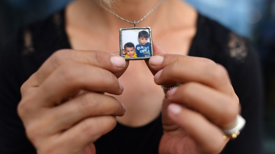 Tima Kurdi holds her necklace bearing a photograph of her nephews, Alan (left) and Ghalib Kurdi. She is the author of <em>The Boy on the Beach: My Family's Escape from Syria and Our Hope for a New Home. </em><em></em>