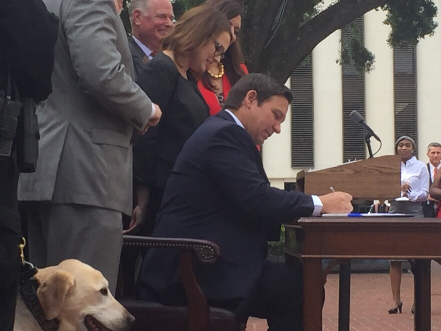 Gov. Ron DeSantis signs into law a bill that brings more severe penalties for intentionally killing a law enforcement canine or horse.