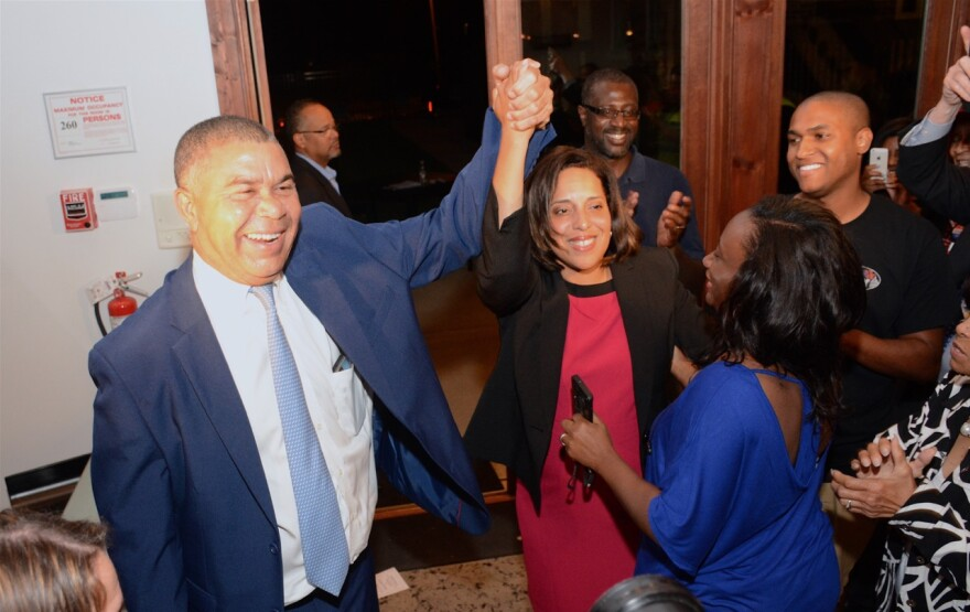 U.S. Lacy Clay raises the arm of Kim Gardner in victory at the Exodus Gallery after the primary election. Gardner made history as the first African-American to hold the office of circuit attorney. Behind her is Alderman Jeffrey Boyd, and to the right is s