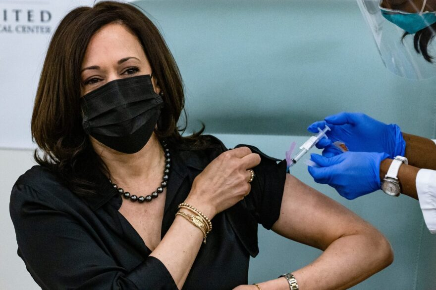 Vice President-elect Kamala Harris is administered a COVID-19 vaccine by registered nurse Patricia Cummings at the United Medical Center in Washington, DC.