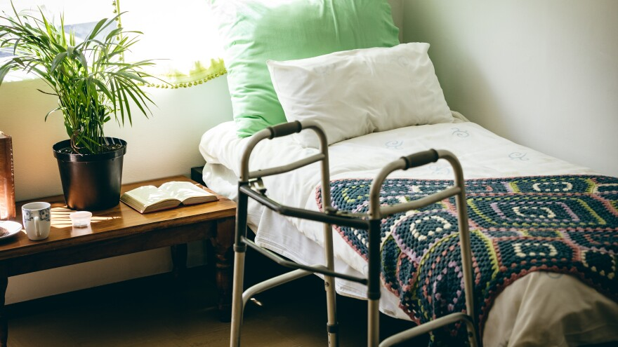 nursing home bed and resident's walker