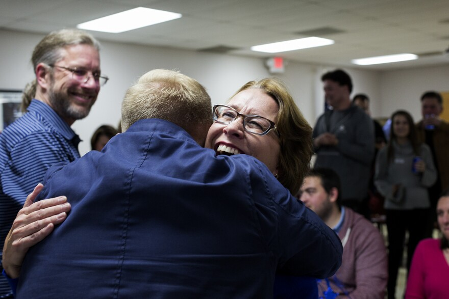 Democrat Trish Gunby is congratulated by her son, Kyle Gunby, who worked on her campaign, after winning a traditionally Republican Missouri House seat in the 99th District.  Nov. 5, 2019