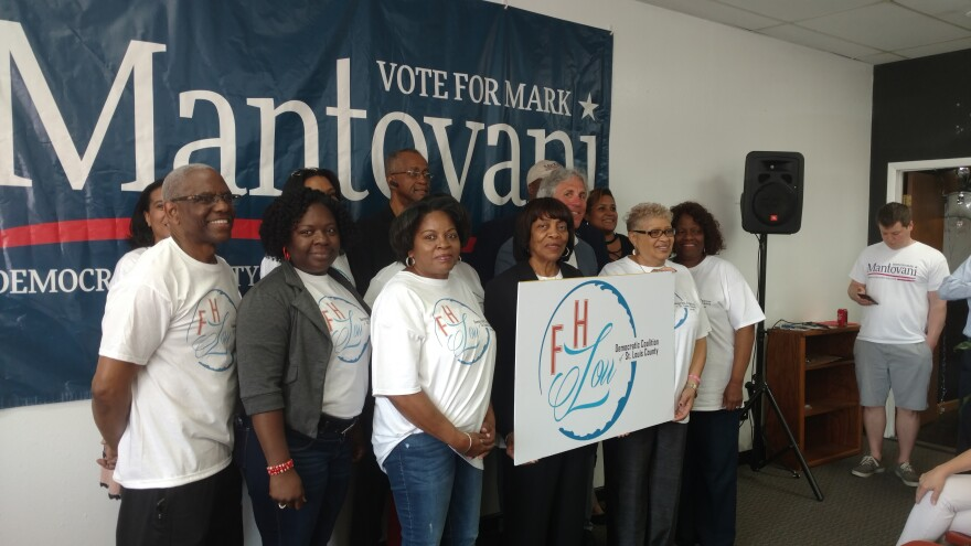 Members of the Fannie Lou Hamer Democratic Coalition stand with businessman Mark Mantovani, in back, at an endorsement event on May 5, 2018.