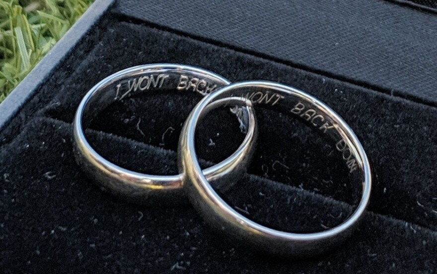 "The phrase ""I won't back down"" is engraved on the wedding rings of Niki Vonderwell and her husband, Matthias Luft."
