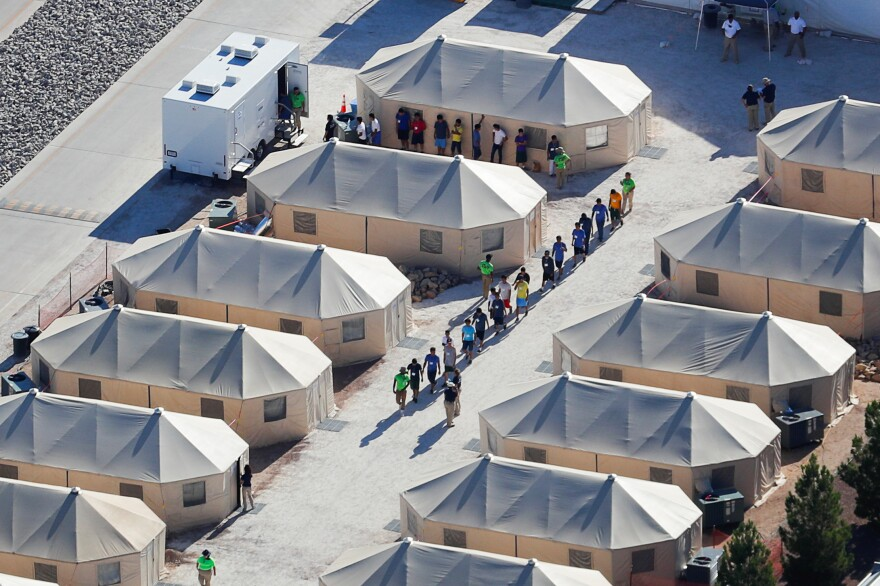 """Migrant children now housed in a tent encampment under the Trump administration's """"zero tolerance"""" policy are shown walking in single file at the facility near the Mexican border in Tornillo, Texas, on June 19."""