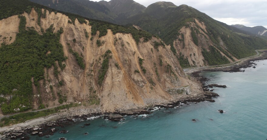 An aerial photo taken Monday shows earthquake damage to State Highway One near Ohau Point in New Zealand, a day after a powerful magnitude 7.8 earthquake killed two people and caused massive infrastructure damage.