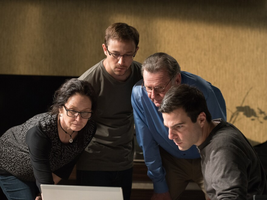 """This image released by Open Road Films shows, from left, Melissa Leo as Laura Poitras, Joseph Gordon-Levitt as Edward Snowden, Tom Wilkinson as Ewen MacAskill and Zachary Quinto as Glenn Greenwald, in a scene from """"Snowden."""""""