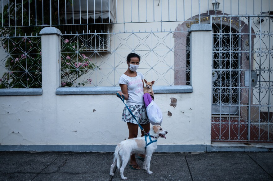 Cristiane Silva takes her dogs for a walk. As a freelance photojournalist, I work much of the time on the street, with significant amount of interaction with other people. After two months at home, things have changed drastically. <em>April 6, 2020. Rio de Janeiro.</em>