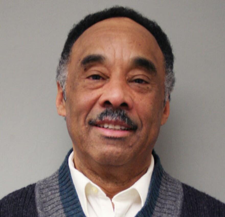 Robert Holmes, 67, is a professor at Rutgers University.