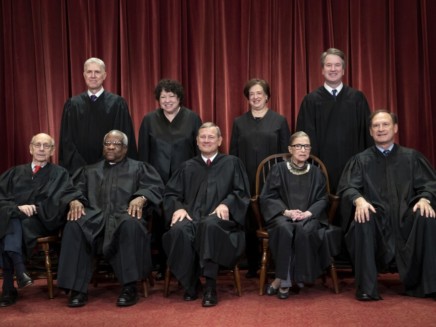 The justices of the U.S. Supreme Court gather for a group portrait.
