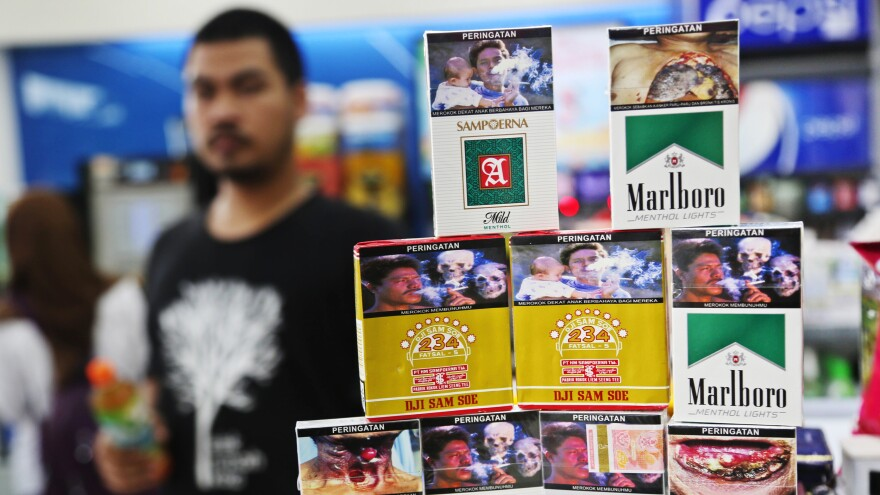 Cigarette packages deliver a public health message in Indonesia.