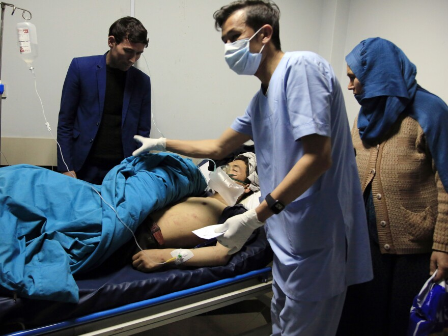 An unidentified patient receives treatment at a hospital after a suicide attack in Kabul, Afghanistan, on Saturday. At least 18 people, including children, were reported dead.