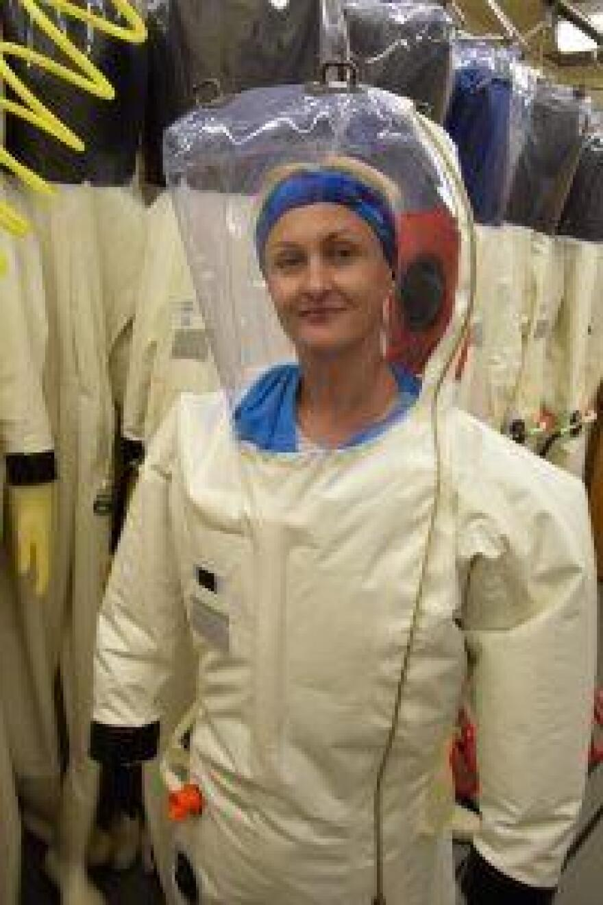 Texas Biomed scientist Olena Shtanko suits up to study Ebola infected mice in one of its biosafety level four labs.