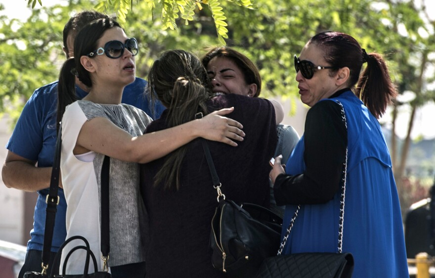 Families of passengers who were flying in an EgyptAir plane that vanished from radar en route from Paris to Cairo react as they wait outside the Cairo airport on Thursday.