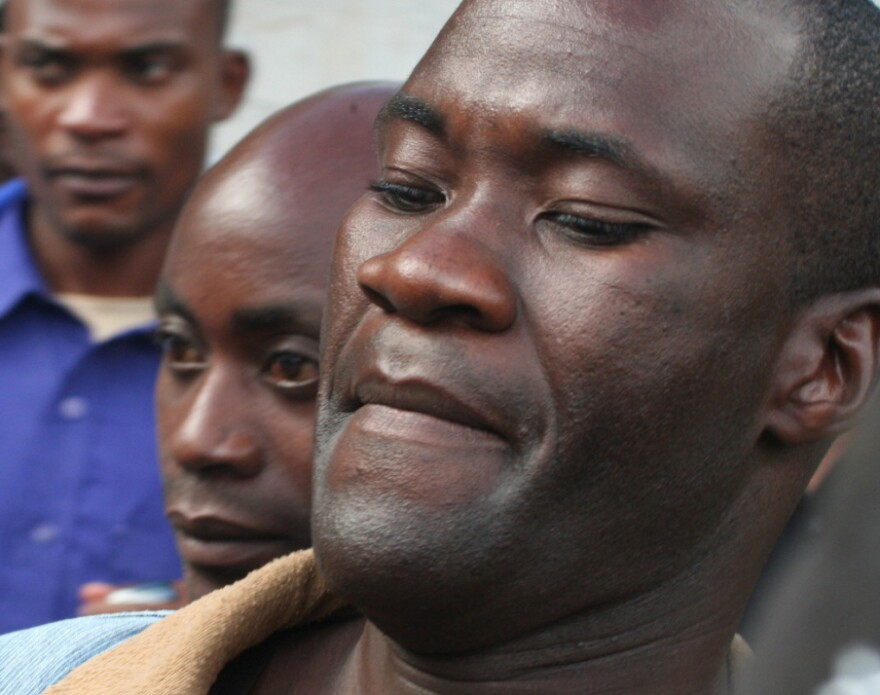 """In 2010, Tiwonge Chimbalanga, right, and Steven Monjeza, left back, were sentenced to  14 years in prison for """"unnatural acts"""" and """"gross indecency"""" under Malawi's anti-gay legislation."""