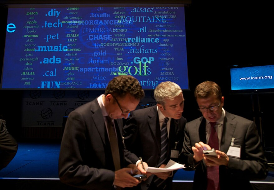Journalists examine new 'Generic Top-Level Domain Names (gTLDs) during a press conference hosted by ICANN in central London, on June 13, 2012. The US-based Internet Corporation for Assigned Names and Numbers (ICANN) was to reveal details of 1,930 requests for new web address endings at a press conference in London. The California-based body says the huge expansion of the Internet, with two billion users around the world, half of them in Asia, means the new names are essential.(Andrew Cowie/AFP/GettyImages)