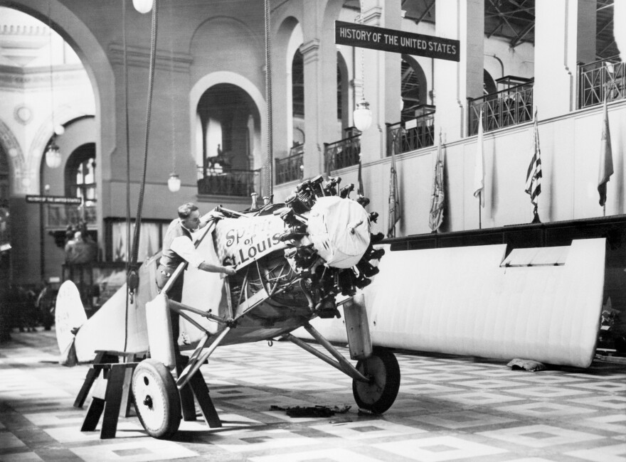 In 1928, when Charles Lindbergh gave his Spirit of St. Louis to the Smithsonian, it was first displayed in the Arts and Industries Building. Here a Smithsonian worker reassembles the plane near the building's rotunda.