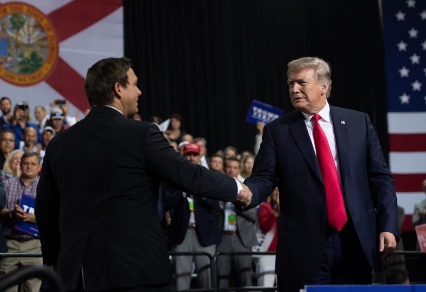 US President Donald Trump shakes hands with then US Representative Ron DeSantis, Republican of Florida. DeSantis is now Florida's governor, and the subject of a public records lawsuit set to be filed by The Miami Herald.